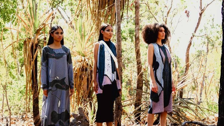 Three women in silk dresses