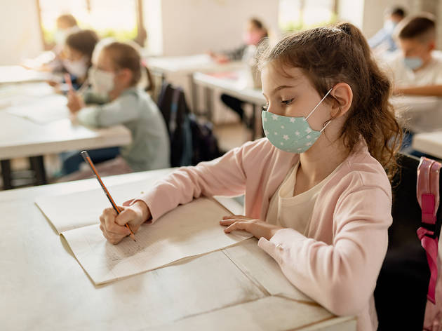 child in school wearing a mask
