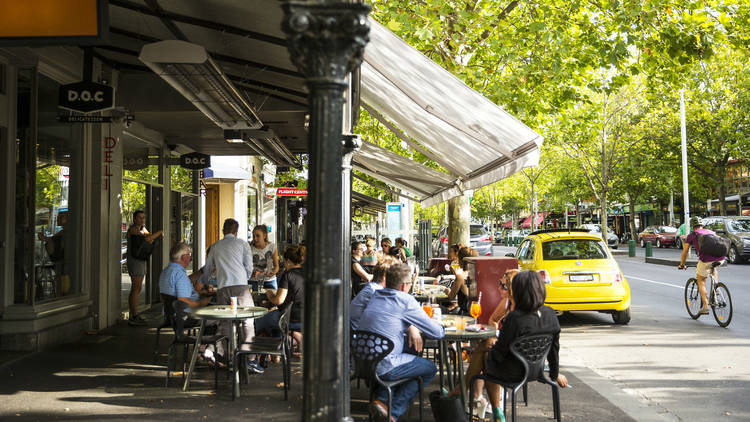 People dining outdoors on Lygon Street
