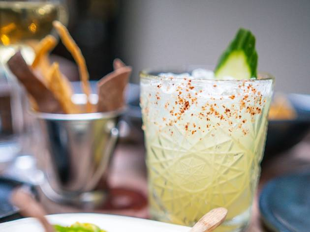 margarita with a cucumber sticking out of it