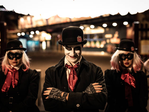Spooky characters stand in front of Luna Park
