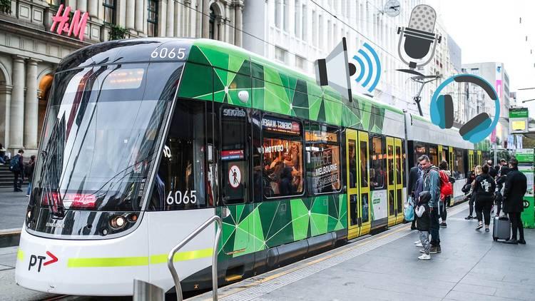 Emojis over tram on Bourke Street
