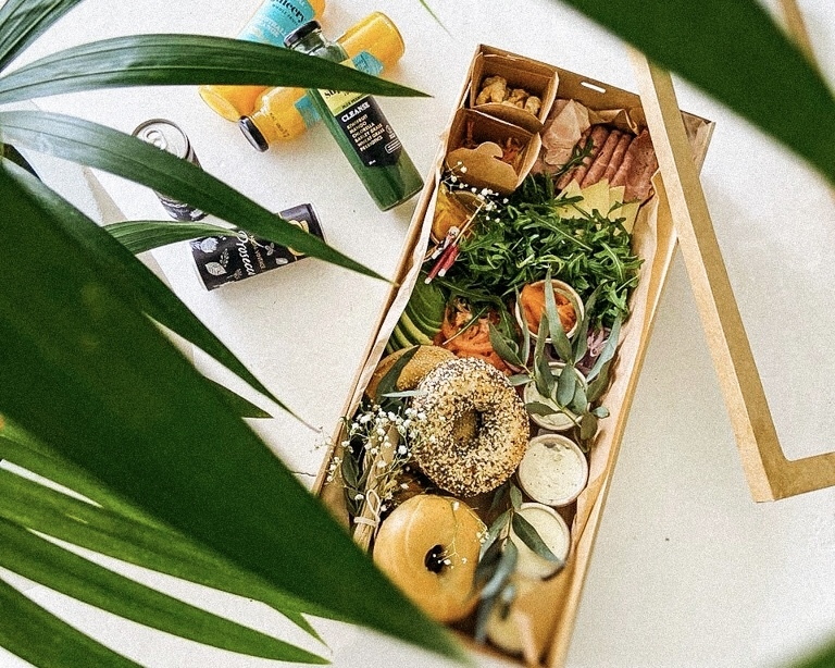 Bagel box featuring spreads, orange juice, prosecco, fillings and more.