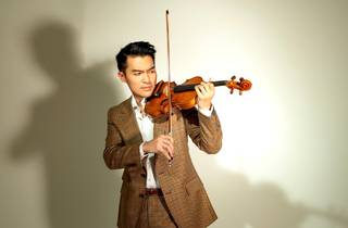 Ace violinist Ray Chen, wearing a natty tweed suit, prepares to play