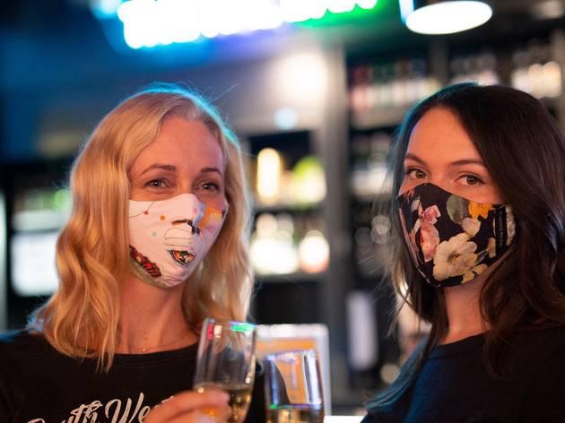 Models wear Belvoir St Theatre x Romance Was Born face masks.