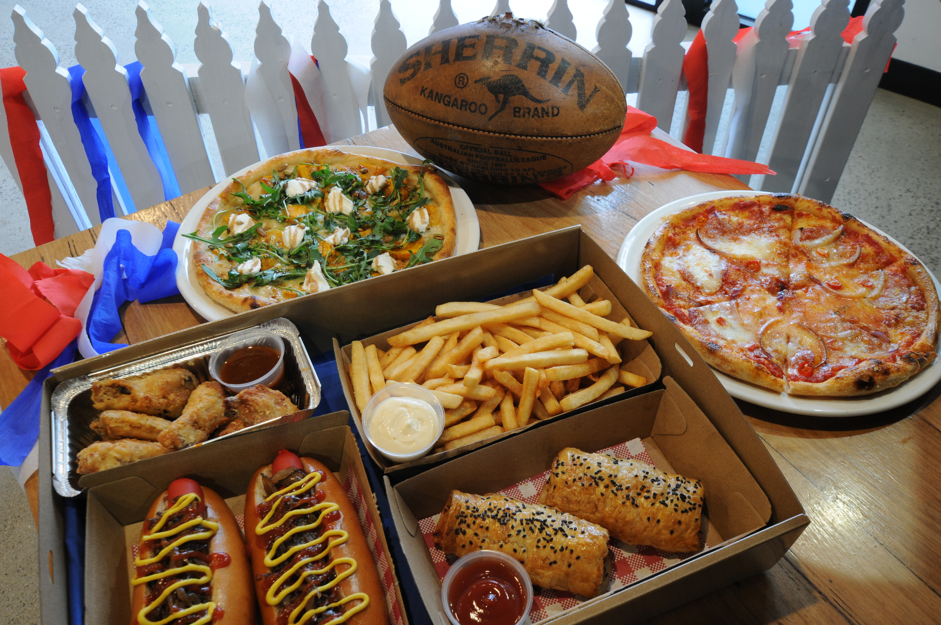 Pizzas, hot dogs, chips, sausage rolls, chicken wings, Sherrin.