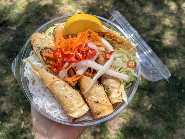 A spring roll vermicelli bowl at a market
