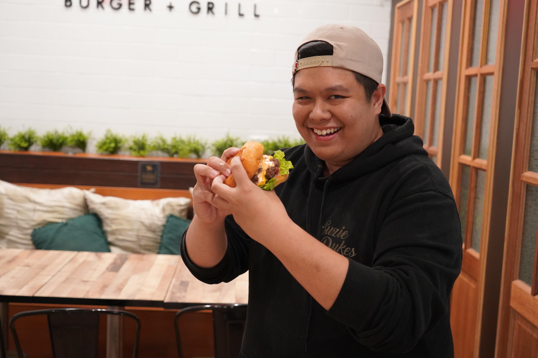 Man holding burger.