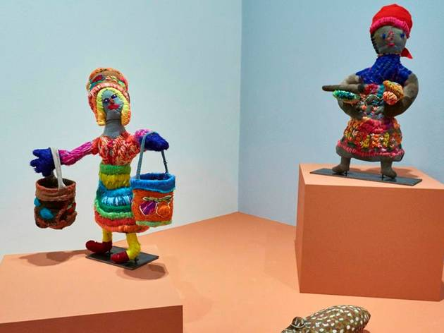 Colourful yarn sculptures of First nations women carrying dilly bags
