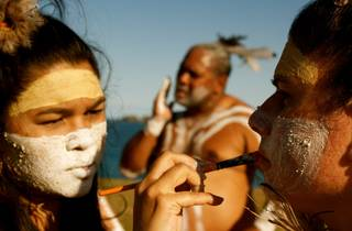 First nations dance troupe Wajaarr Ngaarlu painting traditional marking on their faces