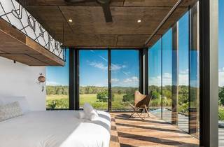 Bedroom with glass walls