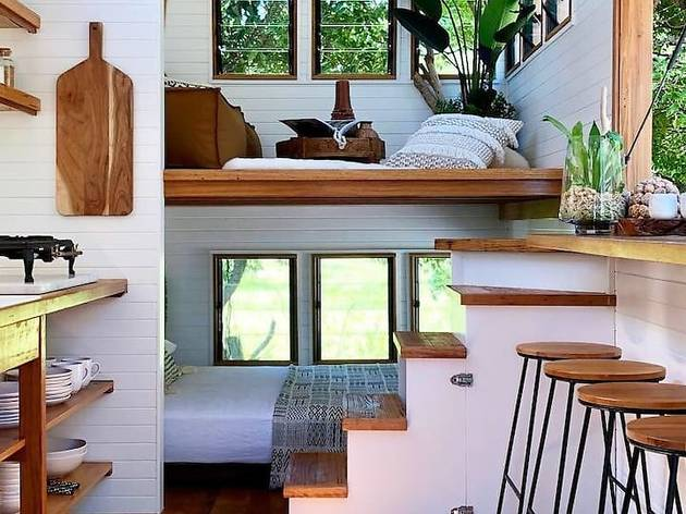 Tiny house interior with stools and stairs
