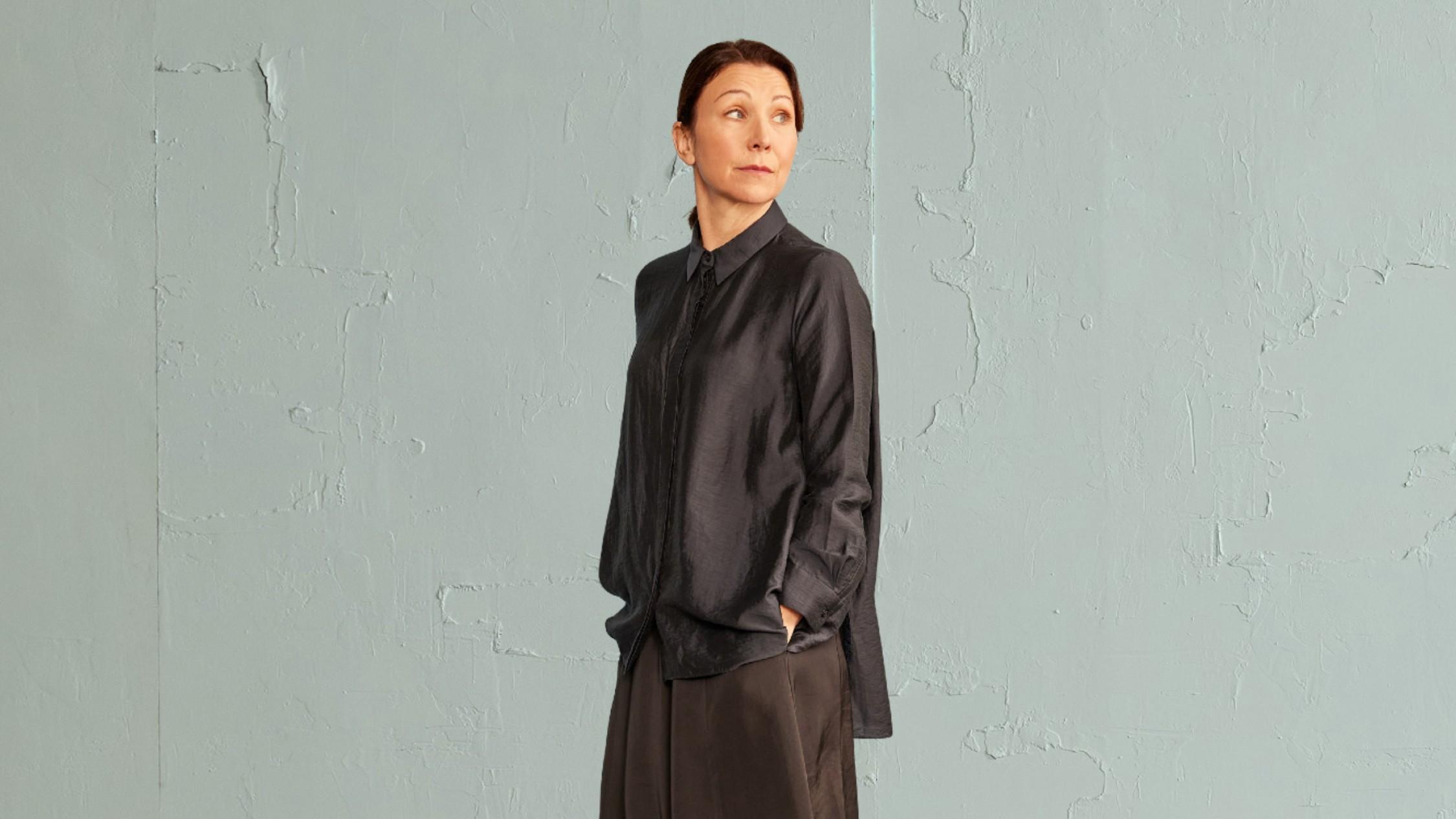 Anita Hegh in dark smocks in Belvoir's A Room of One's Own