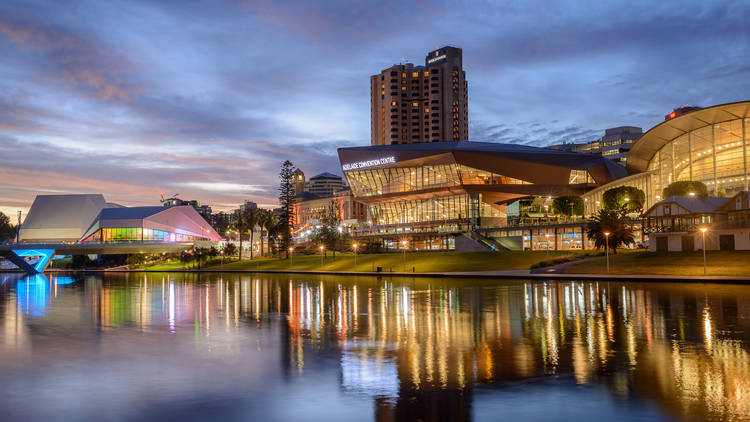The view of Adelaide Festival Centre from across the river at dusk