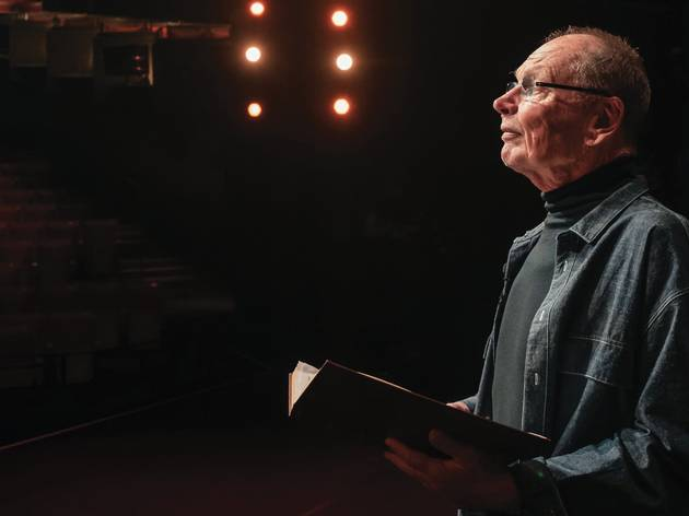 Bell Shakespeare founder John Bell on the Opera House stage, book in hand