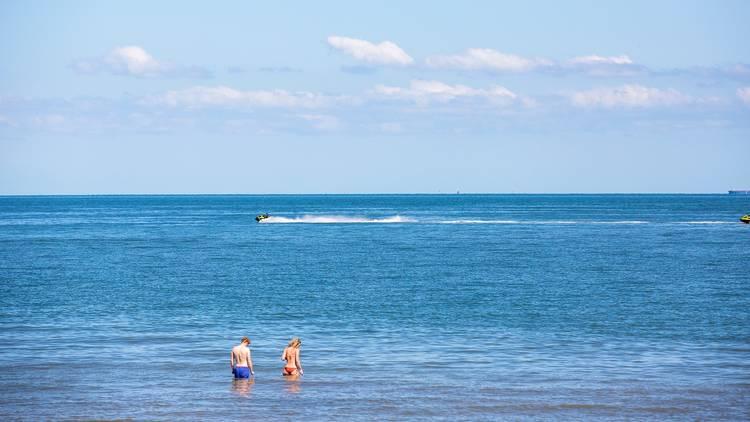 People wading at St Kilda beach