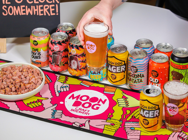 Beers, beer mat, beer nuts, beer glasses and a hand