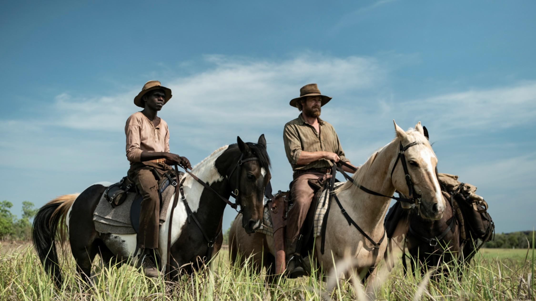 Two Australian cowboys on horseback