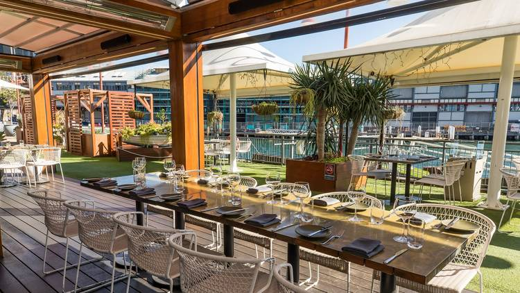Long table with chairs outside on a deck at the Gantry