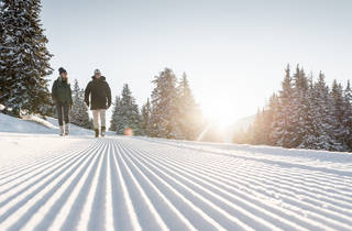 A romantic hike on a snowy hill in Gstaad.