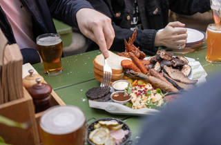 Smoked meats and beers on a table