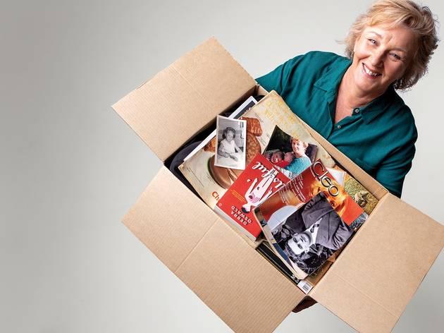 Debra Oswald with a cardboard box full of life mementoes