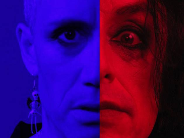 Half a face each of iOTA in blue and Paul Capsis in red light, side-by-side