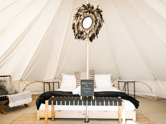Interior of glamping tent with queen bed