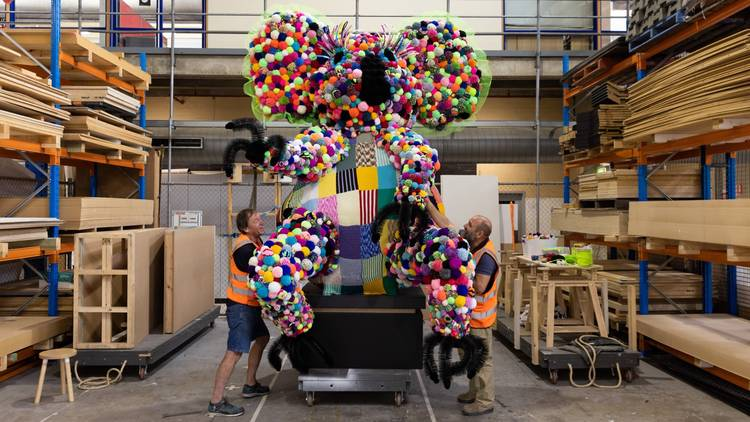 A giant koala made of colourful pom-poms under construction before heading to the Powerhouse Museum
