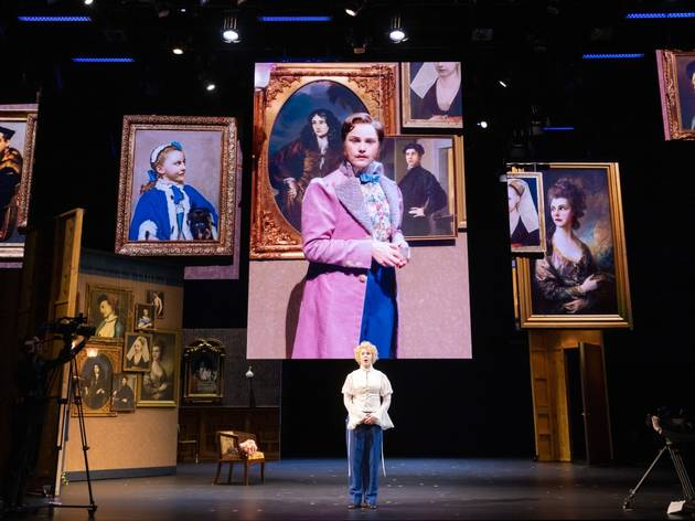 Eryn Jean Norvill surrounded by screen images of her playing multiple characters in The Picture of Dorian Gray