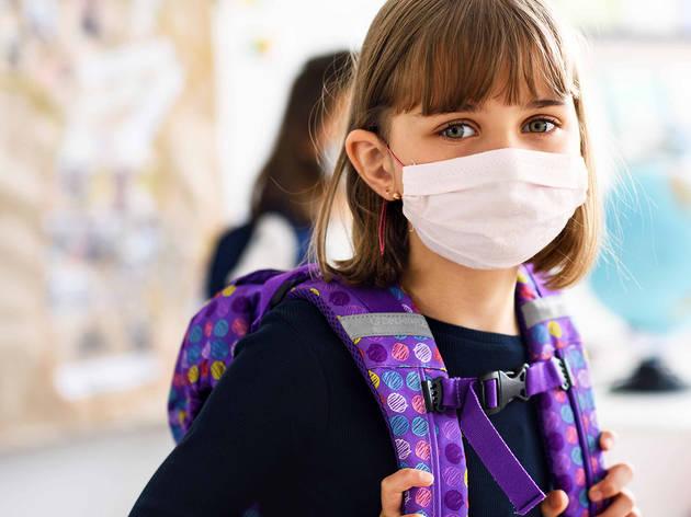 child in school in mask