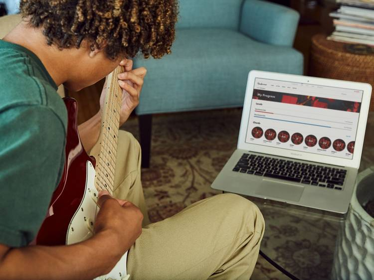 Learn to play guitar (like, properly)