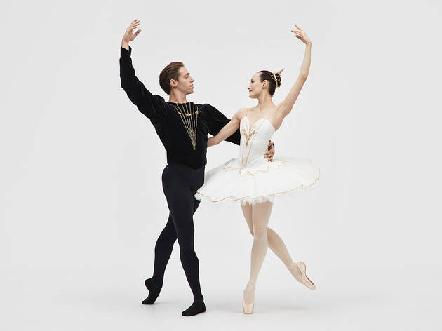 A man and a woman in a joined ballet pose