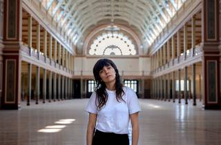 Indie rock star Courtney Barnett in white t-shirt and black jeans alone in Melbourne's beautiful Royal Exhibition Building