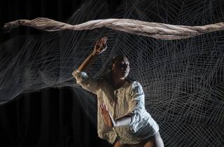 First nations woman JasminSheppard performing a dance inspired by the lyrebird