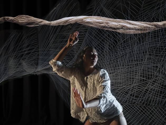 First nations woman Jasmin Sheppard performing a dance inspired by the lyrebird