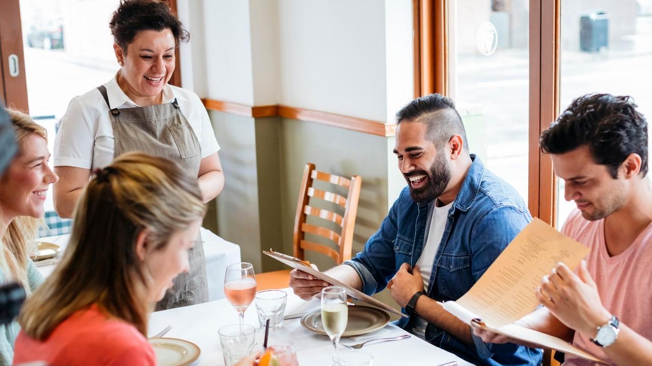 A waitress taking restaurant orders