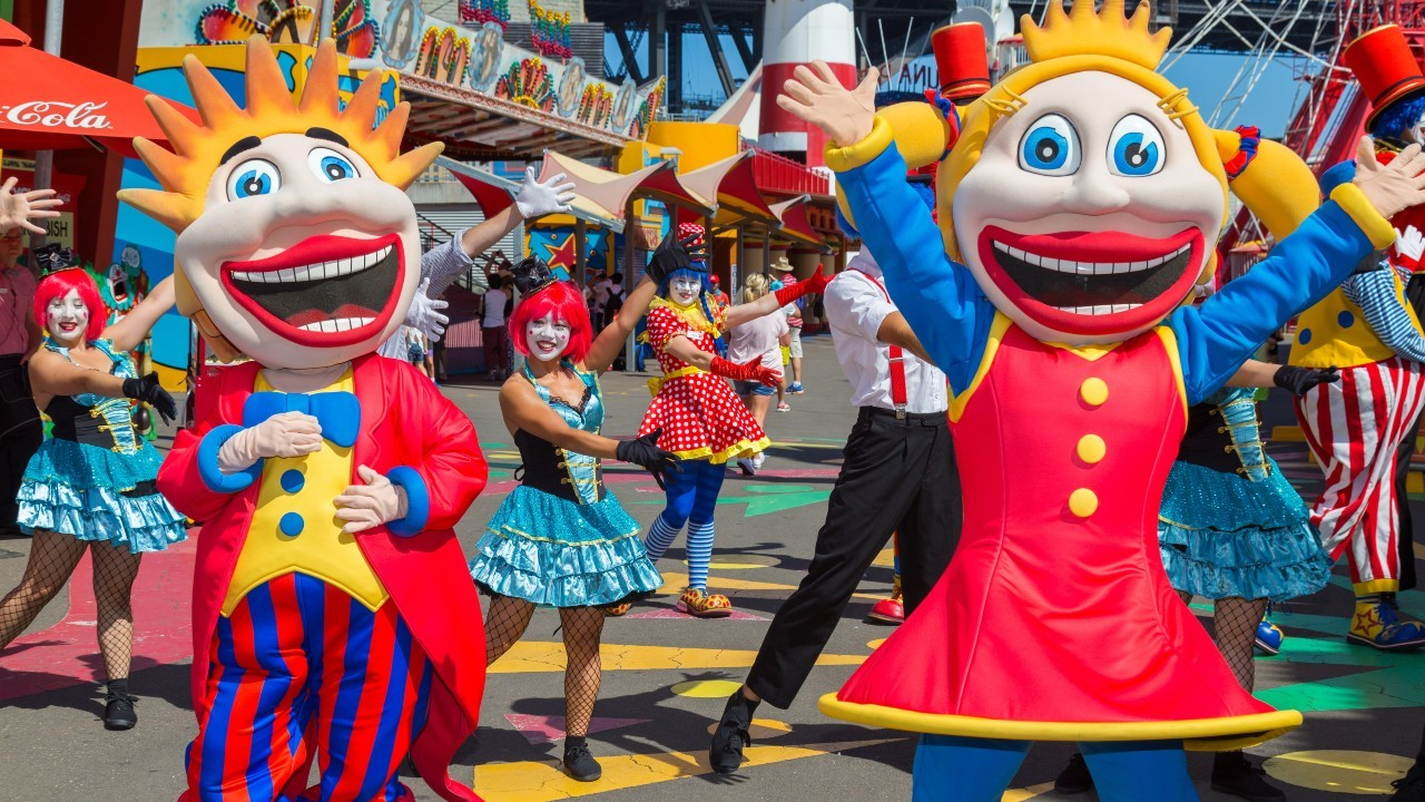 Performers in costume as the Luna Park clown