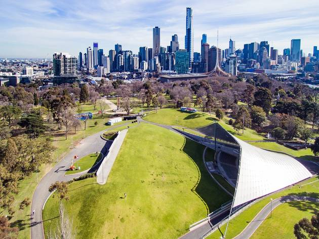 A shot of the Sidney Myer Music Bowl from above. The Melbourne skyline is in the background