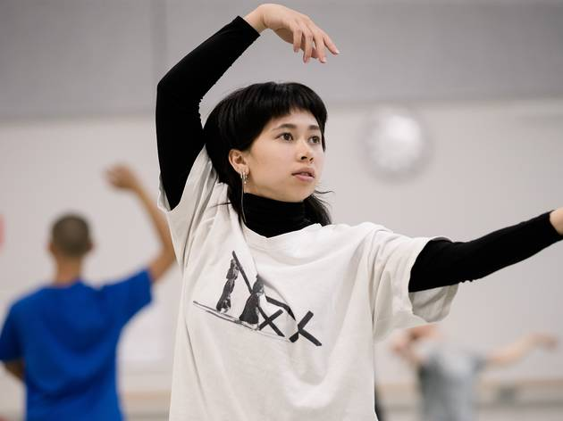Young person in dance class wears black turtle neck sweater and loose tshirt.