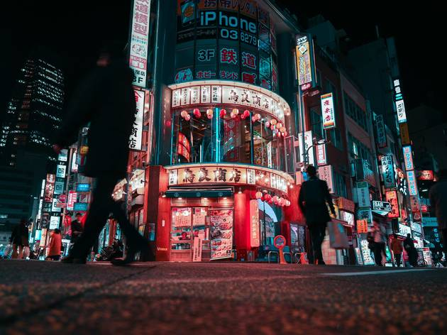 A street at night in Tokyo's Shinjuku nightlife district