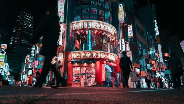 A street at night in Tokyo's Shinjuku nightlife district