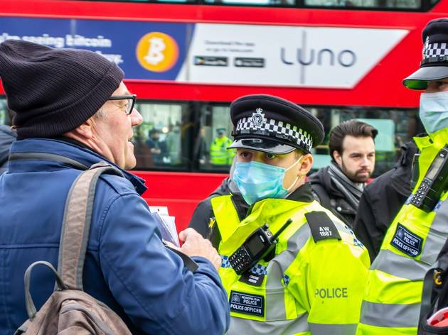 metropolitan police and man without face mask