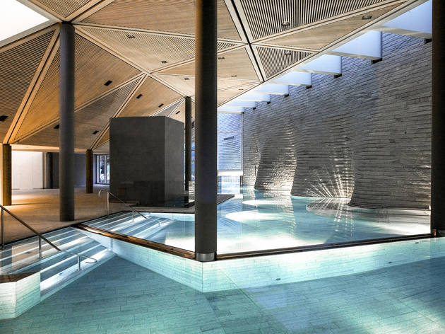 A modern spa and swimming pool inside a hotel.