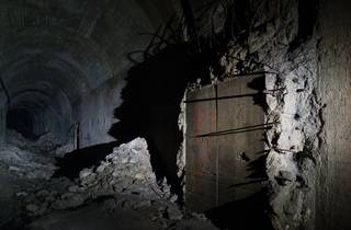 A spooky dark tunnel in blasted concrete and steel far below Sydney