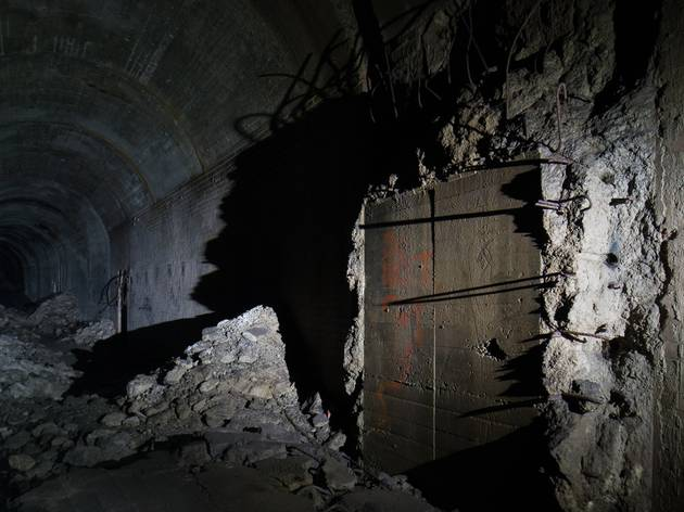 A spooky dark tunnel in blasted concrete and steel far below Sydney