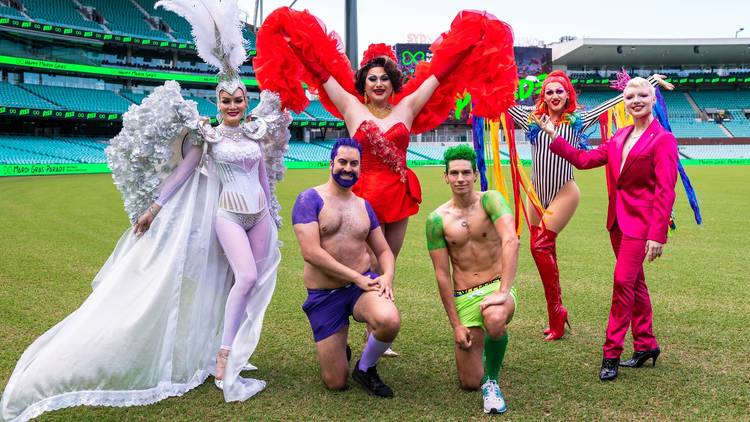 Performers pose at Sydney Cricket Ground