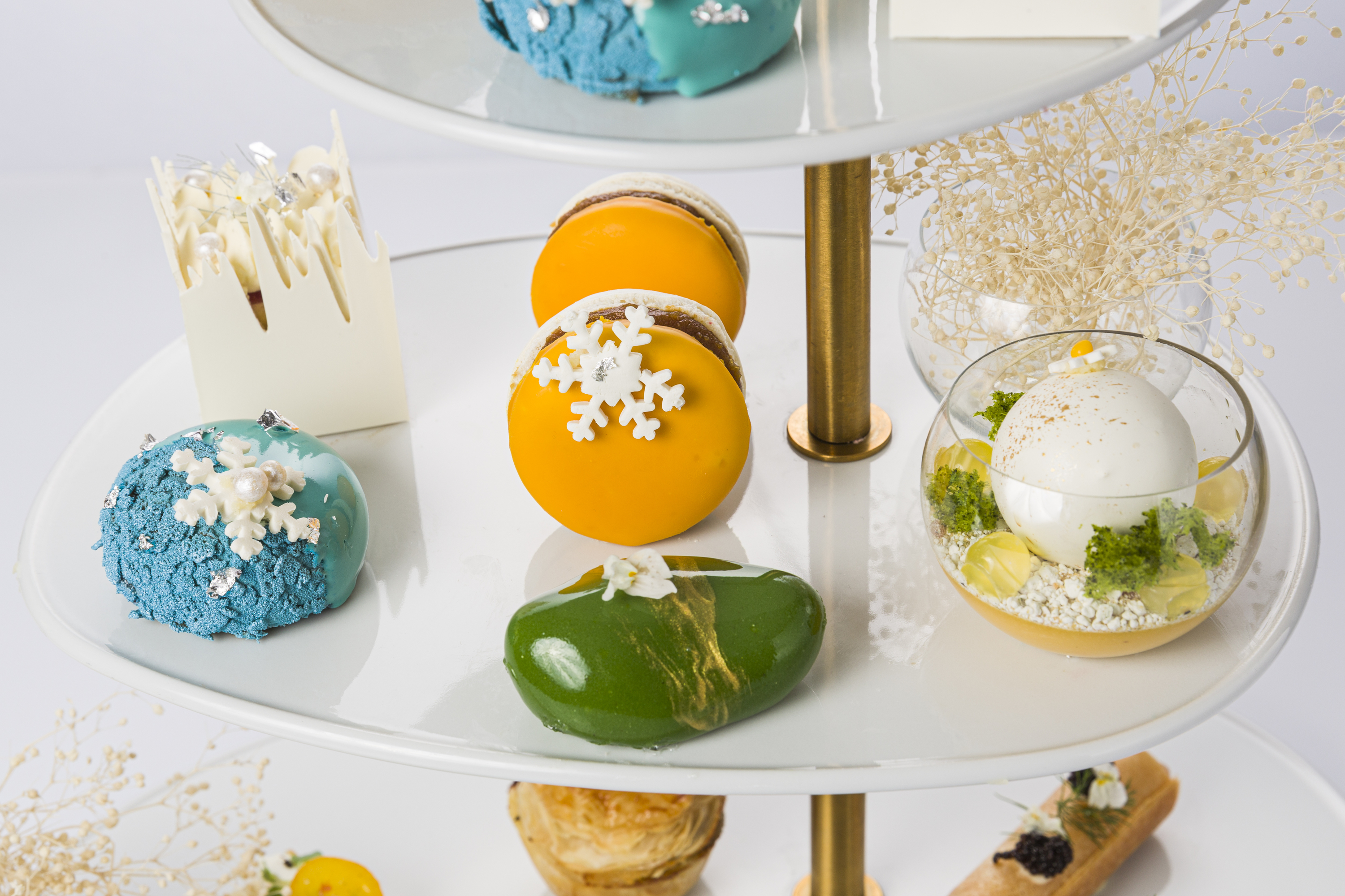 High tea cakes in blue, green and yellow