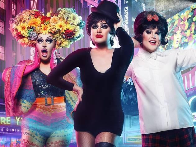 Three drag queens pose in theatre costumes