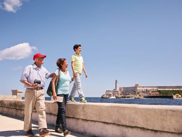 Intergenerational travel – grandparents with child on a trip to Havana